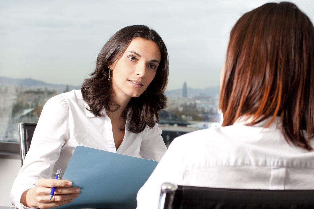 Woman interviewing potential candidate for a job